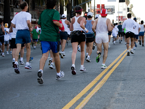 Large group of people running a road race