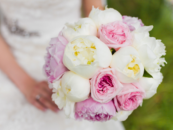 Close up of bride holding boquet